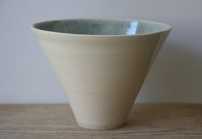 Porcelain vessel with speckled celadon interior