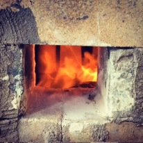 Spying through the front of the kiln. You can see through to some pots in the first ware chamber.